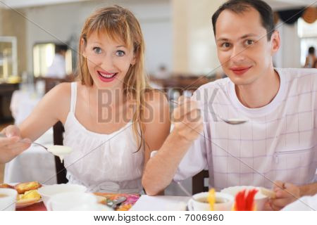 Married Couple Having Breakfast At Restaurant, Eating Cream Wheat