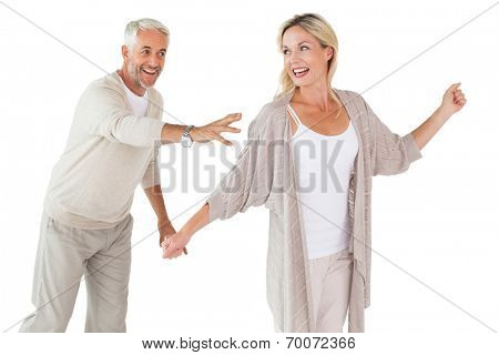 Happy couple messing about together on white background