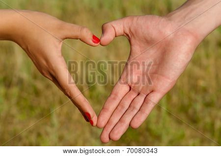 Hands folded pair of heart-shaped