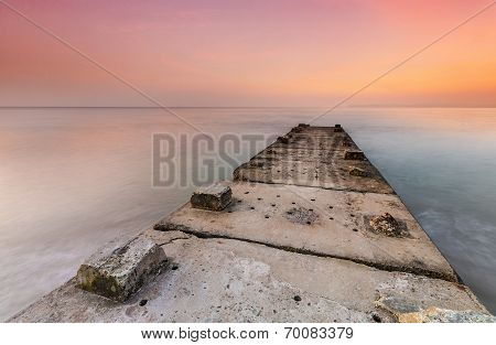 Stone Jetty And Calm Seas