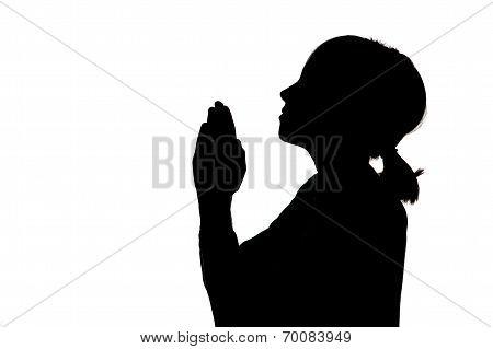 Silhouette Of Girl Praying.