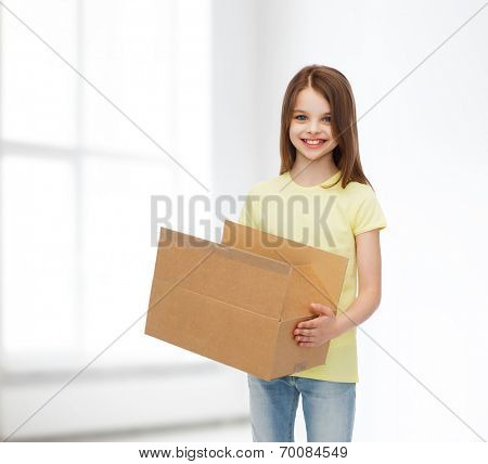 advertising, childhood, delivery, mail and people - smiling little girl holding open cardboard box over white room background