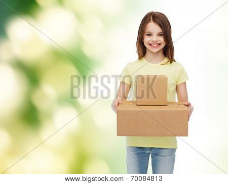 advertising, childhood, delivery, mail and people - smiling little girl holding cardboard boxes over green background