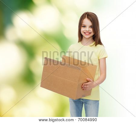advertising, childhood, delivery, mail and people - smiling little girl holding open cardboard box over green background