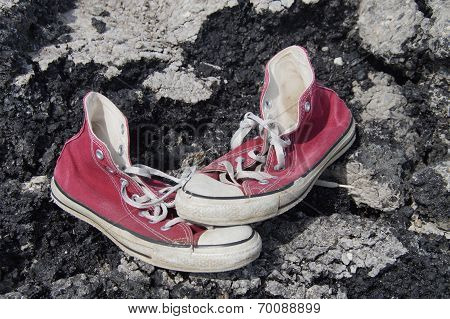 Old Red Canvas Shoes - Asphalt Background