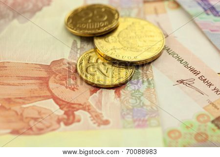 New ukrainian golden coins and banknotes macro background