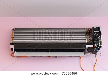Air conditioner during the installation process - radiator with copper tubes and plates