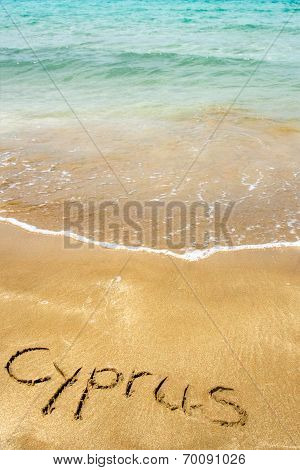Cyprus Written In Sand On Beach With Sea In Background