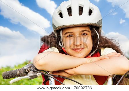 Portrait of beautiful girl in white helmet