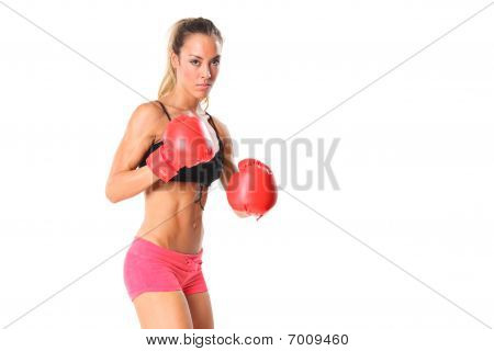 Beautiful young woman with red boxing gloves