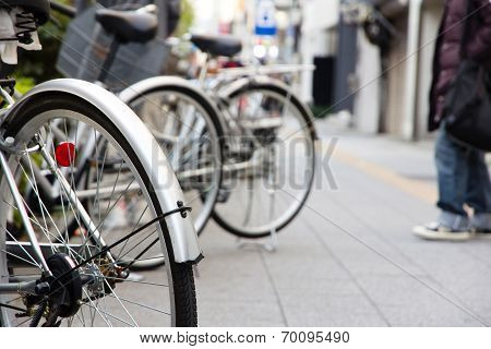Bicycles parked on a street in Tokyo, Japan