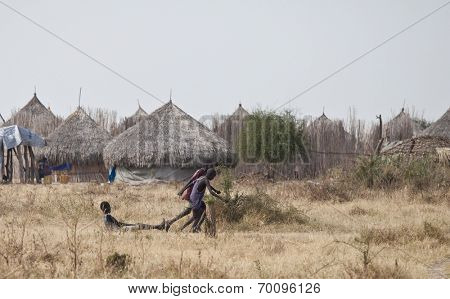 MANGALLA, SOUTH SUDAN-DECEMBER 2: Children run and play near the village of Mangalla in South Sudan
