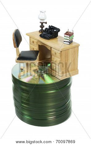 Desk With Typewriter On Stack Of Disks