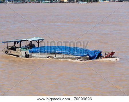 Cargo Vessel On Mekong River