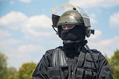 stock photo of anti-terrorism  - Spec ops soldier in black uniform and face mask with his rifle