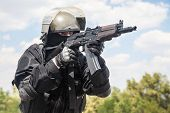 stock photo of anti-terrorism  - Spec ops soldier in black uniform and face mask with his rifle - JPG