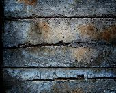 stock photo of dimples  - Dark and old and concrete wall with large cracks - JPG