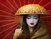 stock photo of geisha  - a woman dressed up like a geisha - JPG