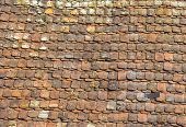 picture of red roof tile  - red old istoric roof tile pattern in harmonic structure - JPG