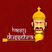 picture of dussehra  - Face of angry Ravana burning in fire with the help of an arrow on tha wintage rad background with the stylish text of Dussehra - JPG