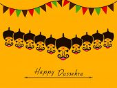 pic of dussehra  - Angry faces of Ravana with his ten heads and small colorful flags on yellow background for Happy Dussehra celebrations - JPG