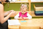 image of montessori school  - Mother and child girl playing in kindergarten in Montessori preschool Class - JPG