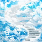 foto of sun god  - Spiral stairs in sky with clouds and sun - JPG