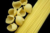 Macaroni And Spaghetti On The Black Background poster