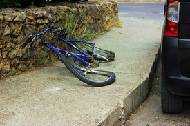 stock photo of crippled  - Deformation of bicycle after accident on the street - JPG