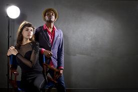 picture of pompous  - stylish actors posing on a concrete background with pompous expression - JPG