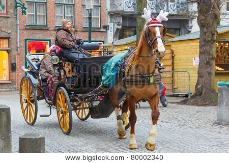 Horse carriageon the street of Brugge Christmas, Belgium.