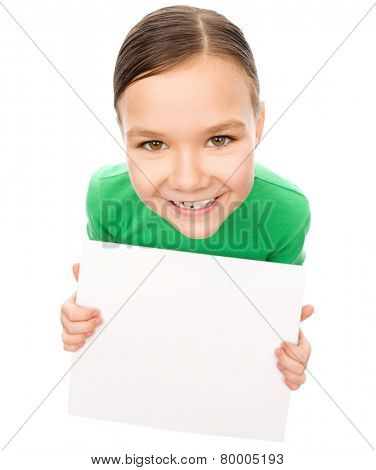 Happy little girl is holding blank board, fisheye portrait, isolated over white