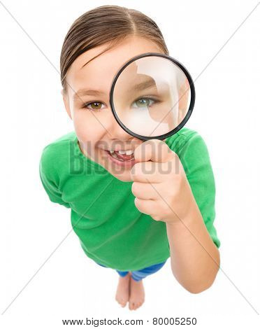 Funny little girl is looking through magnifier, fisheye portrait, isolated over white