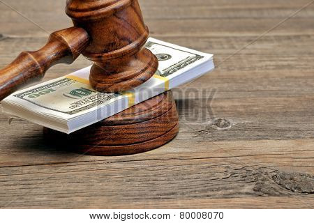 Wad Of Money And Judges Gavel