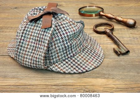 Deerstalker Hat, Retro Magnifying Glass And Large Old Key