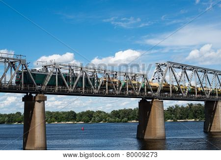 Railroad Bridge In Kyiv Across The Dnieper With Freight Train