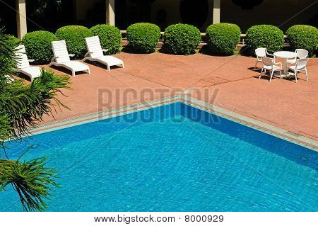 Swimming Pool And Chaise Longues