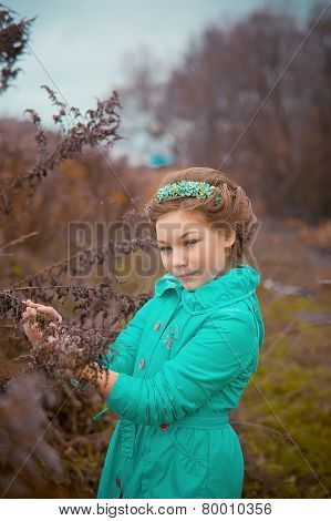 Portrait of shy young child girl in dark forest