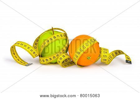 Measuring Tape Around The Orange And Green Apple. Concept Slim Figure
