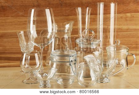 Different glassware on wooden background