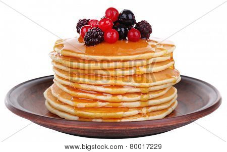 Stack of delicious pancakes with berries and honey isolated on white
