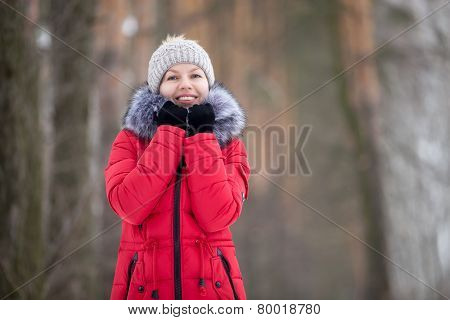 Female Portrait Outdoors In Red Winter Jacket, Looks In Camera
