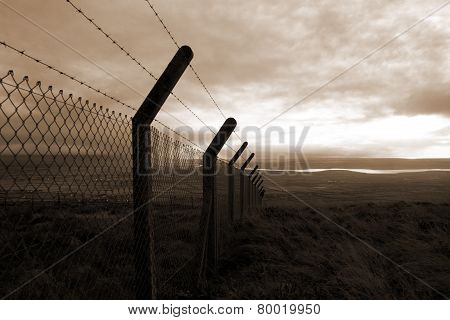 Sepia Barbed Wire Fencing And Scenic View