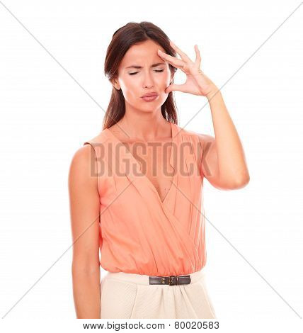 Pretty Hispanic Woman With Hand On Head