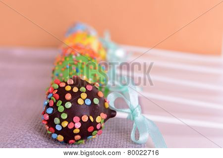 Sweet cake pops on table on beige background