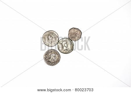 Four Silver Antique Coins On A White Background