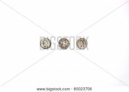 Three Antique Silver Coins On White Background
