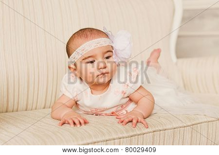 Little cute baby-girl in dress