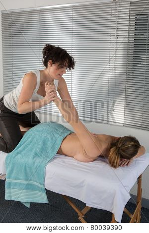Woman Lying On Mat Receiving Massage From Thai Therapist