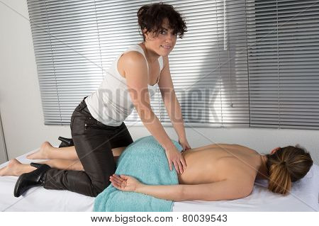 Two Women Perfoming Thai Massage